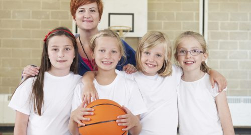Portrait Of Teacher With Girls School Basketball Team ** Note: Soft Focus at 100%, best at smaller sizes